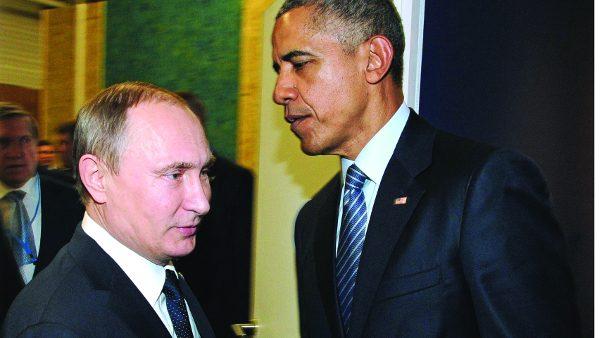 Russian President Vladimir Putin, left, and U.S. President Barack Obama shake hands at the COP21 UN Conference on Climate Change in Paris, France, Monday, Nov. 30, 2015. (Mikhail Klimentyev/Sputnik, Kremlin Pool Photo via AP)/MOSB101/671091208666/POOL/1511301516