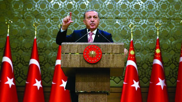 "Turkey's President Recep Tayyip Erdogan speaks during an event for foreign investors, in Ankara, Turkey, on Tuesday, Aug. 2, 2016. Erdogan said, once more blasted unnamed Western countries which he says supported an attempted coup on July 15 which left more than 270 people dead. ""The West is supporting terrorism and taking sides with coups."" (Kayhan Ozer/Presidential Press Service, Pool Photo via AP)/AXPK106/16215497460524/POOL PHOTO/1608021555"